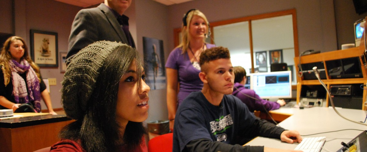 Image of students working in news studio